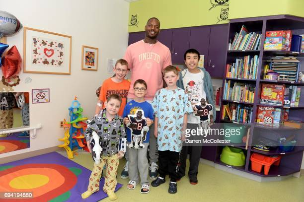 Martellus Bennett takes a picture with Dylan Ransom Ryan Travis and Tri at Boston Children's Hospital June 9 2017 in Boston Massachusetts