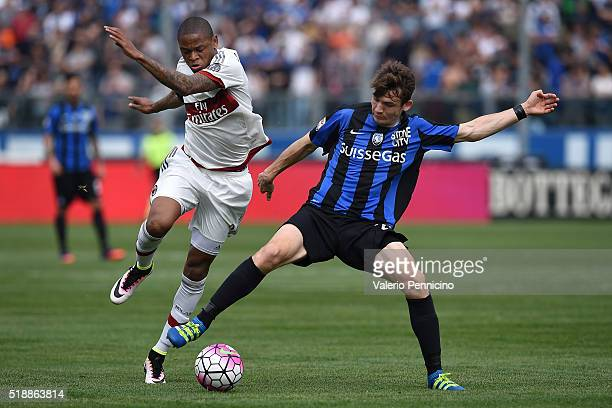 Marten De Roon of Atalanta BC competes with Adriano of AC Milan during the Serie A match between Atalanta BC and AC Milan at Stadio Atleti Azzurri...