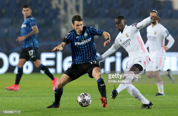 Marten De Roon of Atalanta B.C. Is tackled by Ferland Mendy of Real Madrid during the UEFA Champions League Round of 16 match between Atalanta and...