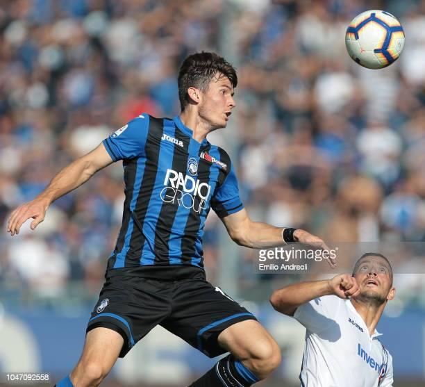 Marten De Roon of Atalanta BC jumps for the ball against Gianluca Caprari of UC Sampdoria during the Serie A match between Atalanta BC and UC...