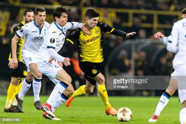 Marten de Roon of Atalanta Bergamo Christian Pulisic of Borussia Dortmund during the UEFA Europa League round of 32 match between Borussia Dortmund...