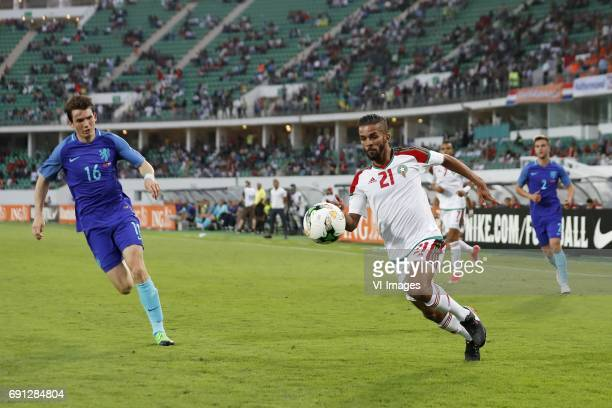 Marten de Roon of Holland Mehdi CarcelaGonzalez of Moroccoduring the friendly match between Morocco and The Netherlands at Grand Stade Adrar on May...