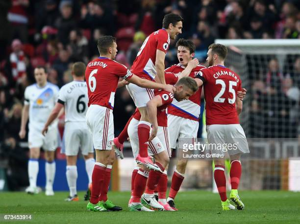 Marten de Roon of Middlesbrough celebrates scoring his sides first goal with team mates during the Premier League match between Middlesbrough and...
