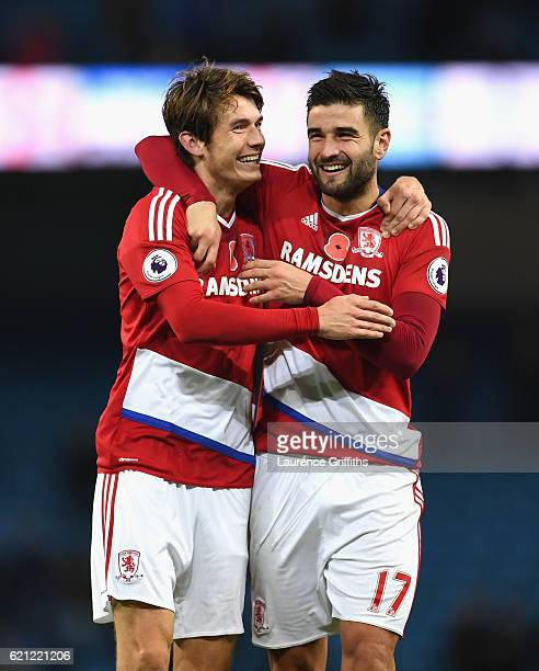 Marten de Roon of Middlesbrough celebrates with Antonio Barragan of Middlesbrough after the game during the Premier League match between Manchester...