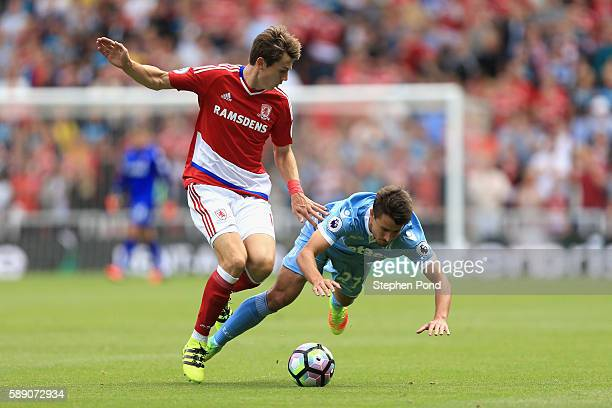 Marten de Roon of Middlesbrough fouls Bojan Krkic of Stoke City during the Premier League match between Middlesbrough and Stoke City at Riverside...