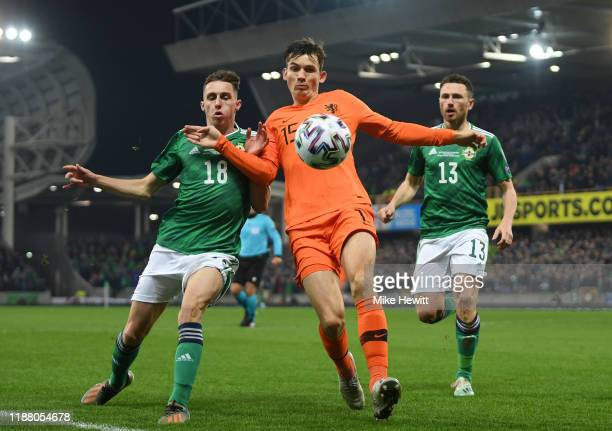 Marten de Roon of Netherlands battles for possession with Gavin Whyte and Corry Evans of Northern Ireland during the UEFA Euro 2020 Group C Qualifier...