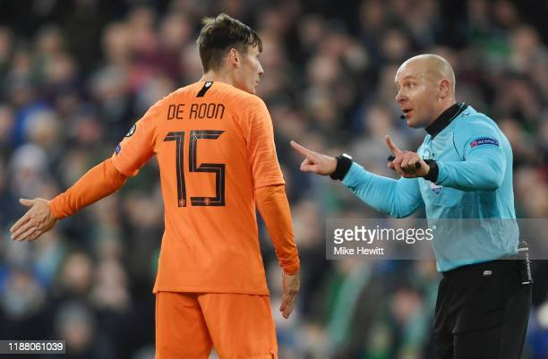 Marten de Roon of Netherlands speaks to match referee Szymon Marciniak during the UEFA Euro 2020 Group C Qualifier match between Northern Ireland and...