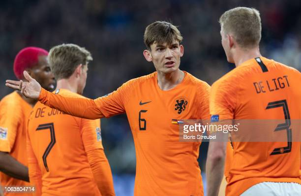 Marten de Roon of the Netherlands gestures with Matthijs de Ligt of the Netherlands during the UEFA Nations League A group one match between Germany...