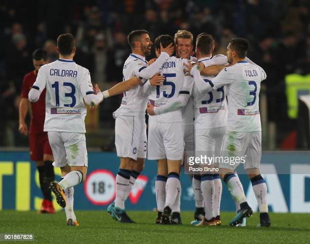 Marten De Roon with his teammates of Atalanta BC celebrates after scoring the team's second goal during the serie A match between AS Roma and...