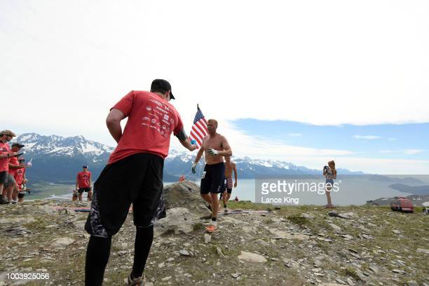 Marten Martensen gets a drink as he passes the top of Mount Marathon during the Men's Division of the 91st Running of the Mount Marathon Race on July...
