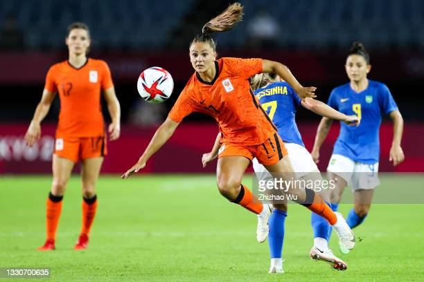 Martens Lieke of Netherlands competes for the ball with Andressinha of Brazil during the Women's First Round Group F match on day one of the Tokyo...