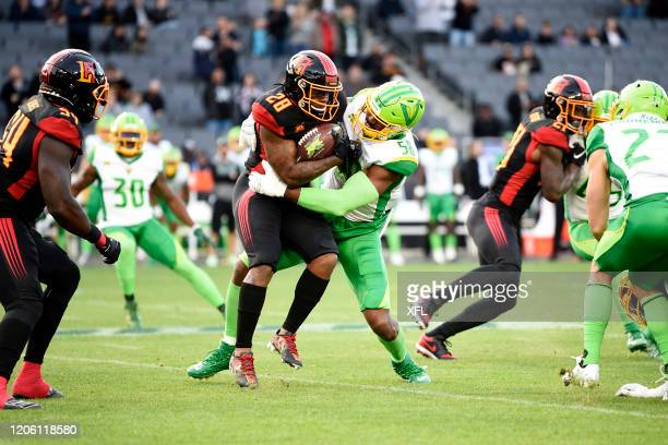 Martez Carter of the LA Wildcats is tackled by Obum Gwacham of the Tampa Bay Vipers during the XFL game at Dignity Health Sports Park on March 8,...