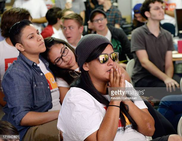 Martha Acevedo and domstic partners Alicia Guajardo and Isabella Restrepo wait for the Supreme Court ruling at a watch party at Equality California a...