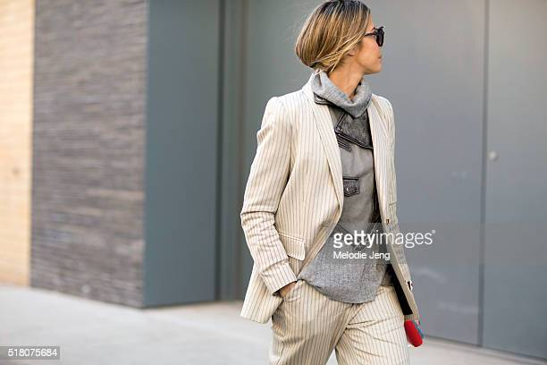 Martha Graeff wears creamcolored Zimmermann striped suit over a gray Diesel leather jacket and gray turtleneck during New York Fashion Week Women's...