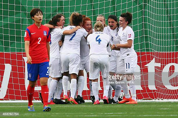 Martha Harris of England celebrates her team's first goal with team mates during the FIFA U20 Women's World Cup Canada 2014 group C match between...