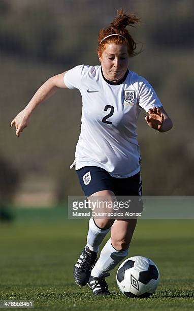 Martha Harris of England runs with the ball during the U23 friendly match between England and Germany at la Manga Club on March 3 2014 in La Manga...