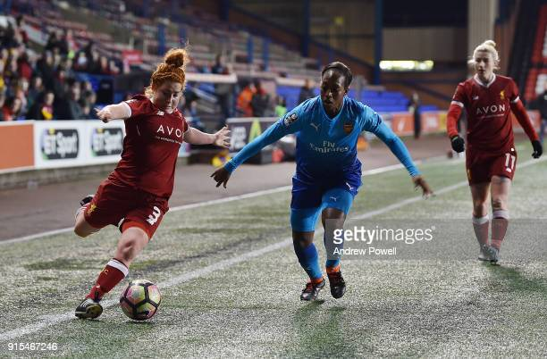Martha Harris of Liverpool Ladies competes with Danielle Carter of Arsenal Women during the Women's Super League match between Liverpool Ladies and...