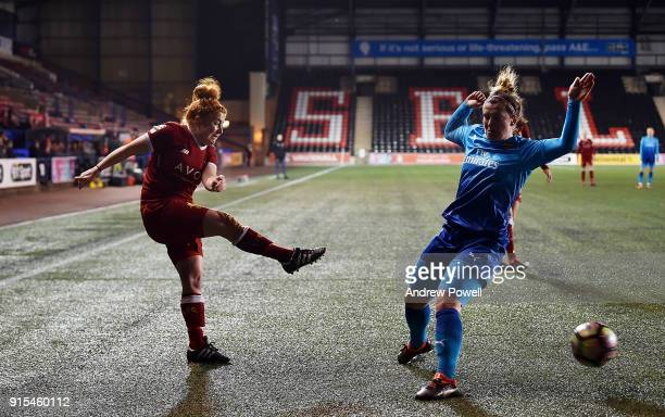 Martha Harris of Liverpool Ladies competes with Emma Mitchell Arsenal Women during the Women's Super League match between Liverpool Ladies and...