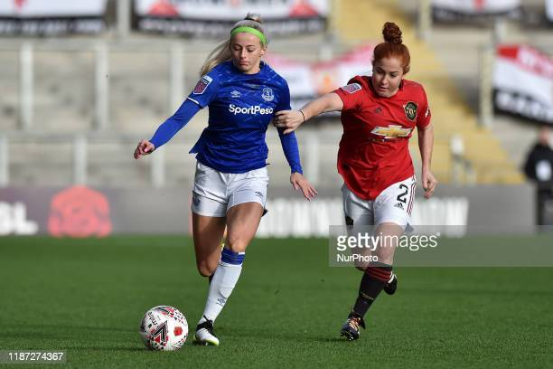 Martha Harris of Manchester United Women and Chloe Kelly of Everton Women in action during the Barclays FA Women's Super League match between...