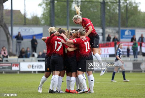 Martha Harris of Manchester United Women celebrates scoring a penalty her team's fourth goal with team mates during the FA Women's Championship match...