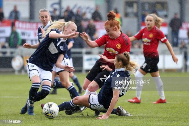 Martha Harris of Manchester United Women is fouled by Lia Cataldo of Millwall Lionesses leading to a penalty awarded to Manchester United Women...