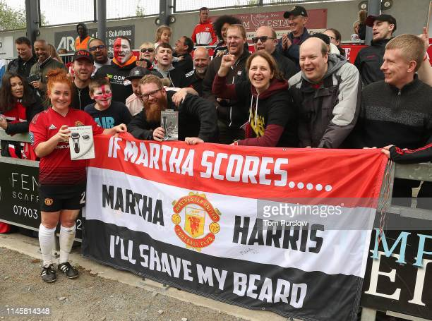 Martha Harris of Manchester United Women poses with fans after the FA Women's Championship match between Manchester United Women and Millwall...