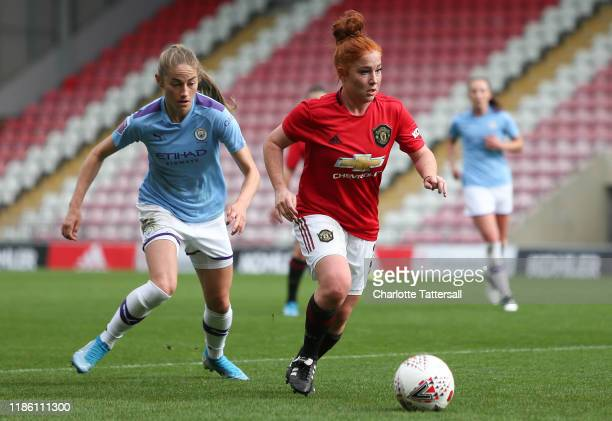Martha Harris of Manchester United Women runs with the ball during the FA Women's Continental League Cup match between Manchester United Women and...