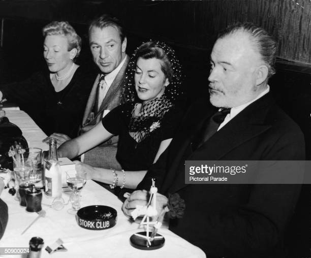 Martha Hemingway actor Gary Cooper his wife Veronica Balfe and author Ernest Hemingway sit in a booth at the Stork Club New York City 1943 Cooper...