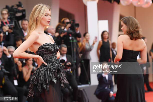 Martha Hunt and Barbara Palvin walk the red carpet ahead of the Opening Ceremony and the La Vérité screening during the 76th Venice Film Festival at...