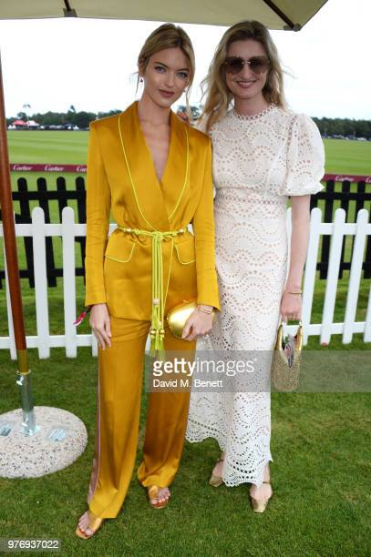 Martha Hunt and Candice Lake attend the Cartier Queen's Cup Polo Final at Guards Polo Club on June 17 2018 in Egham England