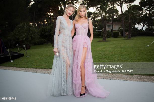 Martha Hunt and Elsa Hosk arrive at the amfAR Gala Cannes 2017 at Hotel du Cap-Eden-Roc on May 25, 2017 in Cap d'Antibes, France.