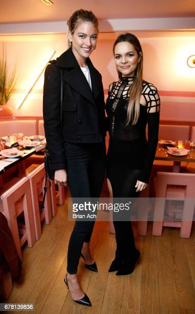 Martha Hunt and Maria Hatzistefanis pose for a photo together as Hatzistefanis and Brad Goreski host Rodial VIP Dinner on May 3 2017 in New York City