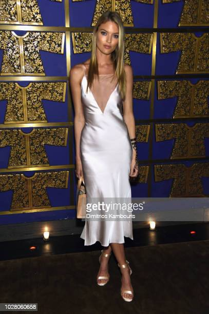 Martha Hunt attends a private dinner hosted by Cindy Crawford Ed Razek and Russell James celebrating 'ANGELS' by Russell James book launch and...