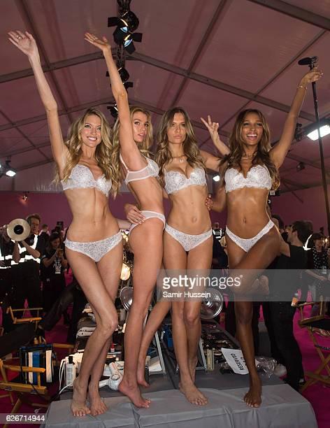 Martha Hunt Devon Windsor Josephine Skriver and Jasmine Tookes pose backstage at the annual Victoria's Secret fashion show at Grand Palais on...
