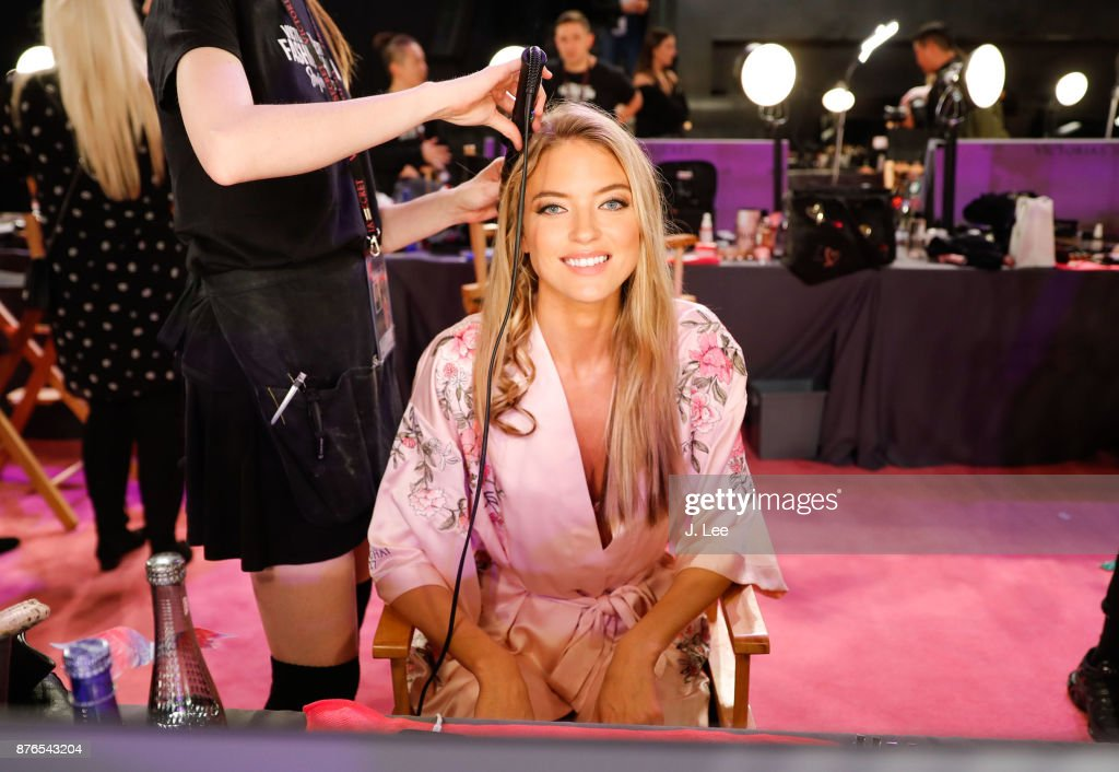 Martha Hunt does hair and makeup backstage for Victoria's Secret Fashion show on November 20, 2017 in Shanghai, China.