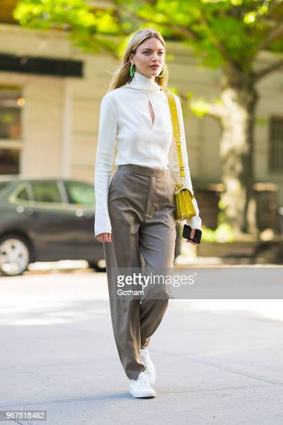 Martha Hunt is seen wearing a Derek Lam shirt with Celine pants and a Kooples handbag in the West Village on May 11 2018 in New York City