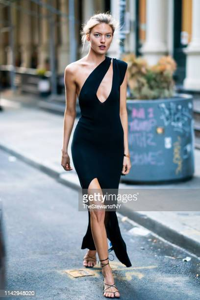 Martha Hunt is seen wearing a Jacquemeus dress with Pluma bracelet in Tribeca on April 15, 2019 in New York City.