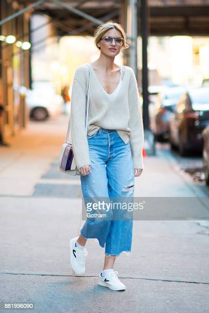 Martha Hunt is seen wearing a Khaite sweater RE/Done jeans Treyton shoes with a Byredo hangbag and vintage sunglasses in Chelsea on November 29 2017...