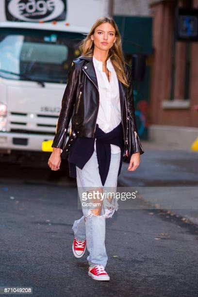 Martha Hunt is seen wearing a Nour Hammour jacket with vintage jeans converse sneakers and Maison Margiela handbag in Chelsea on November 6 2017 in...