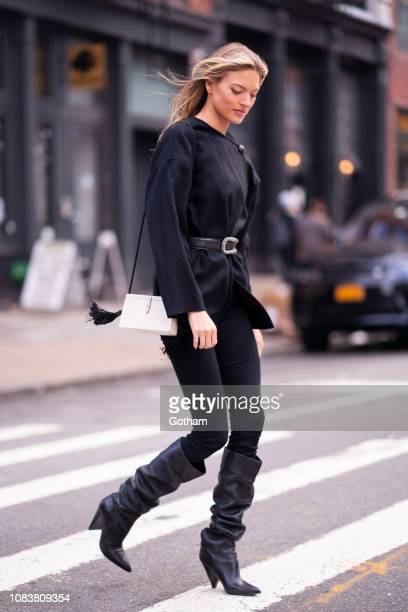 Martha Hunt is seen wearing an Isabel Marant top Paige jeans with a Hunting Season handbag in Tribeca on December 17 2018 in New York City