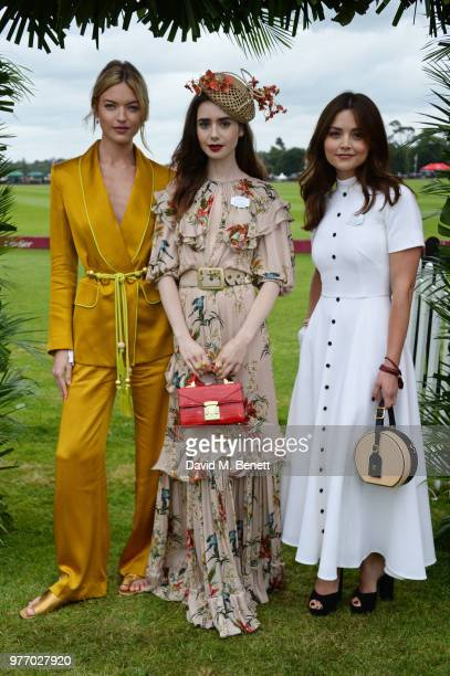 Martha Hunt Lily Collins and Jenna Coleman attend the Cartier Queen's Cup Polo Final at Guards Polo Club on June 17 2018 in Egham England