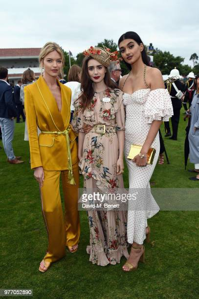 Martha Hunt Lily Collins and Neelam Gill attend the Cartier Queen's Cup Polo at Guards Polo Club on June 17 2018 in Egham England