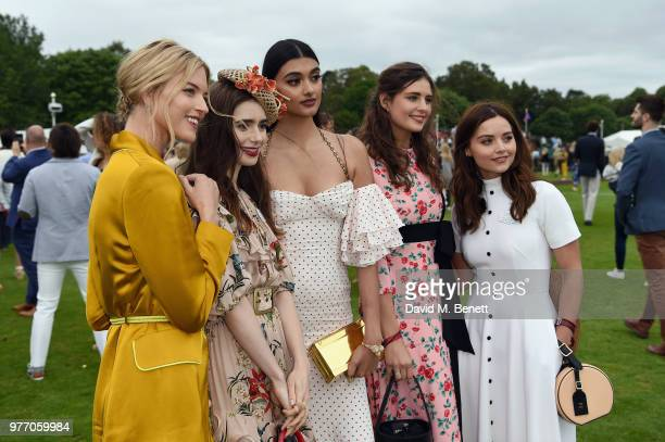 Martha Hunt Lily Collins Neelam Gill a guest and Jenna Coleman attend the Cartier Queen's Cup Polo at Guards Polo Club on June 17 2018 in Egham...