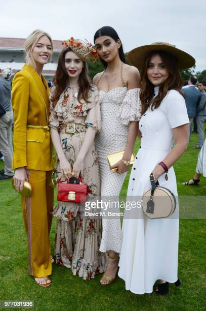 Martha Hunt Lily Collins Neelam Gill and Jenna Coleman attend the Cartier Queen's Cup Polo Final at Guards Polo Club on June 17 2018 in Egham England