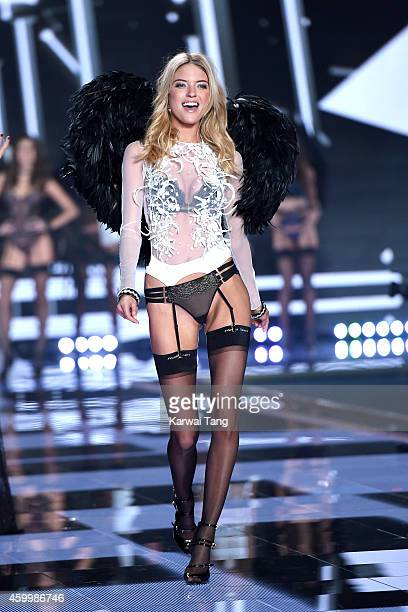 Martha Hunt walks the runway at the annual Victoria's Secret fashion show at Earls Court on December 2 2014 in London England