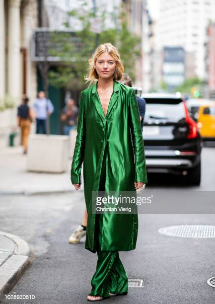 Martha Hunt wearing green button dress and pants seen outside Jason Wu during New York Fashion Week Spring/Summer 2019 on September 7 2018 in New...