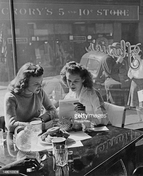 Martha Jean Kuhn shows a friend a letter from her boyfriend an American airman stationed in Britain during World War II Grafton West Virginia 1943