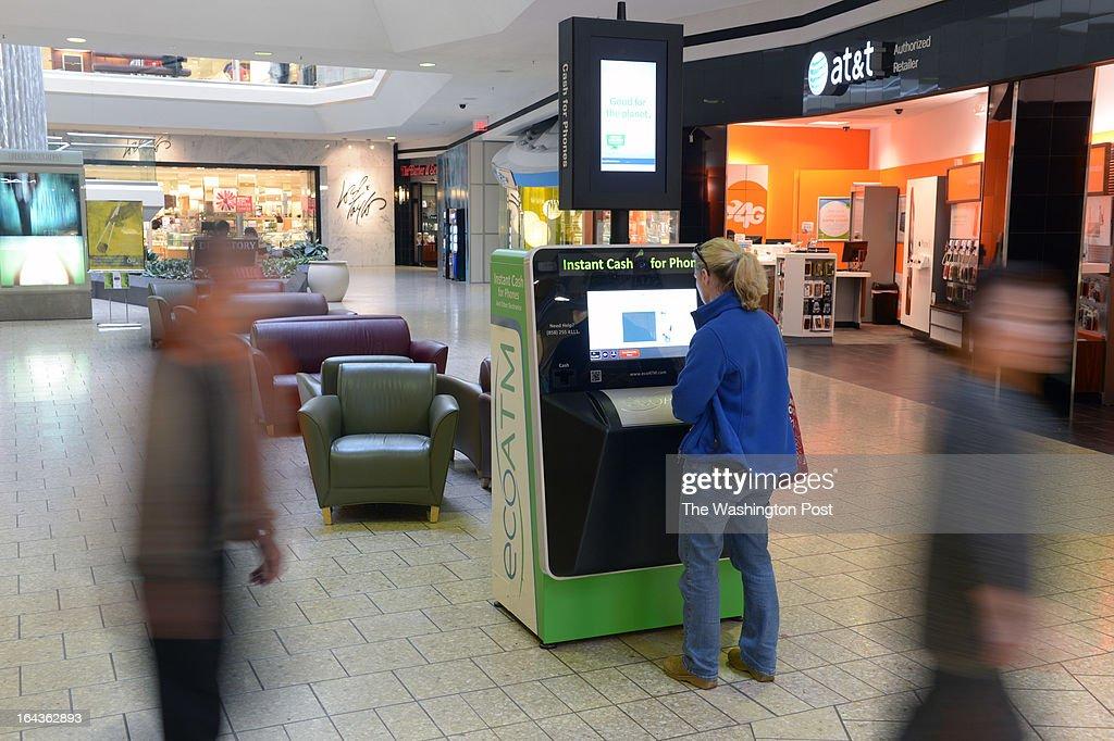 Martha Looney uses an ecoATM at Fair Oaks Mall on Wednesday March 13