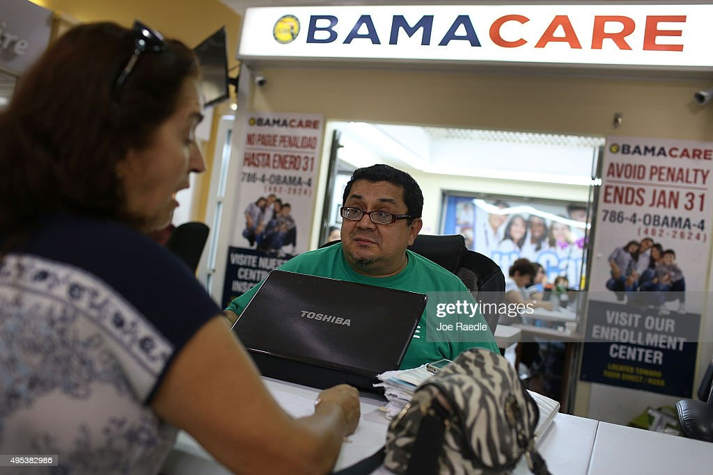 Martha Lucia (L) sits with Rudy Figueroa, an insurance agent from Sunshine Life and Health Advisors, as she picks an insurance plan available in the third year of the Affordable Care Act at a store setup in the Mall of the Americas on November 2, 2015 in Miami, Florida. Open Enrollment began yesterday for people to sign up for a 2016 insurance plan through the Affordable Care Act.