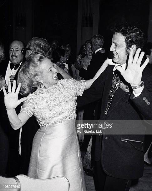 Martha Mitchell and Ron Galella during Feather Ball's 'Just One Break' Benefit May 20 1975 at Plaza Hotel in New York City New York United States
